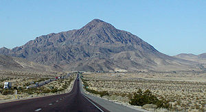 Interstate 15 in California - West of Baker, the freeway jogs north to pass Cave Mountain.