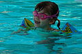 Child wearing inflatable armbands and goggles.jpg