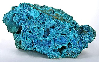 Chrysocolla - Powder-blue chrysocolla as stalactitic growths and as a thin carpet in vugs inside a boulder of nearly solid tyrolite from the San Simon Mine, Iquique Province, Chile (size: 14.1 x 8.0 x 7.8 cm)