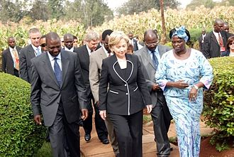 William Ruto - U.S. Secretary of State Hillary Clinton (center) walks with Kenyan Minister of Agriculture William Ruto (left) and Kenyan environmental and political activist Wangari Maathai (right) during a tour of the Kenyan Agricultural Research Institute (KARI) near Nairobi, Kenya 5 August 2009.