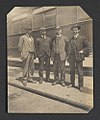 Conductor with Three Men Outside Pullman Car (17144211966).jpg