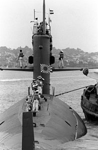Crew members stand on the deck of Mochishio (SS-574), -10 Jun. 1992 b.jpg