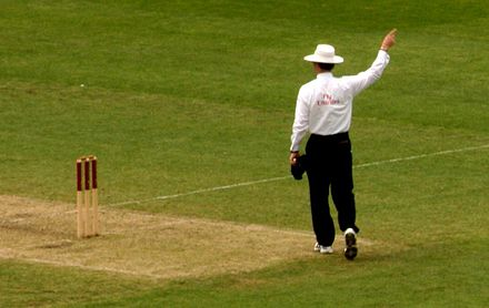 An umpire signals a decision to the scorers Cricket Umpire.jpg