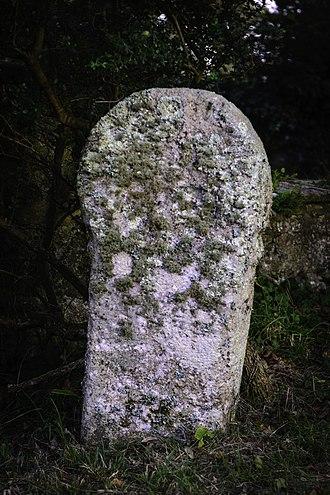 St Enoder - Stone cross in the churchyard of St Enoder