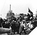 Crowded beach scene with men, supplies, and a boat at left, Nome, Alaska between 1895 and 1905 (AL+CA 862).jpg