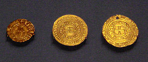 Bezant - Crusader coins of the Kingdom of Jerusalem: Denier in European style with Holy Sepulchre (1162–75); Kufic gold bezant (1140–1180); gold bezant with Christian symbol (1250s) (British Museum). Gold coins were first copied dinars and bore Kufic script, but after 1250 Christian symbols were added following Papal complaints.