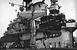 Curtiss SB2C Helldiver is stopped by the crash barrier aboard USS Hancock (CV-19), circa in 1944.jpg
