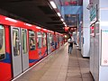 Cutty Sark DLR station platform 1 and train.jpg