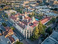 Aerial photograph of the Mission Inn–a four story Spanish revival structure with red tile roofs.