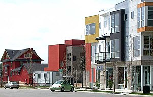 Prospect New Town - View south of Tenacity Drive in Prospect New Town showing a mix of aggregate housing and traditional detached homes.