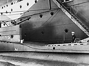 Damage to the casing of HM Submarine THRASHER after two bombs struck her off Crete on the night of 15-16 February 1942. Neither exploded and both were removed by two members of the crew. A8710