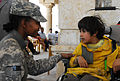 Defense.gov News Photo 110402-A-CE832-193 - U.S. Army Pfc. Diamond Madison left helps fit a pediatric wheelchair to a disabled child at the Anbar Operations Center in Anbar province Iraq.jpg