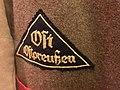 Deutsches Historisches Museum 2019-10-13 lowres Nazi Germany uniform jacket Hitler-Jugend HJ Gebietsdreieck Ost Ostpreussen regional triangle badge 3823.jpg