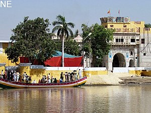 Sadh Belo - Devotees reach the Sadh Belo temple, which is situated in the middle of the Indus River.