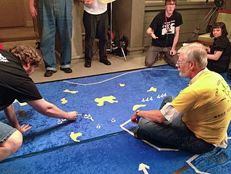 Don't Give Up the Ship! - Mike Carr (in yellow) runs Don't Give Up the Ship at Gen Con 2013