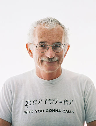 Doron Zeilberger - Photograph of Doron Zeilberger displaying a hypergeometric identity on his T-shirt.