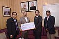 Dr. Jitendra Singh receiving a cheque for J&K flood relief.jpg
