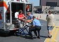 Emergency services personnel prepare to transport a mock victim during exercise Golden Eagle III at Stewart Air National Guard Base, Newburgh, N.Y., June 1, 2013 130601-Z-VX101-041.jpg