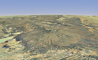 Computer-generated image of Emi Koussi from south, highlighting its form of shield volcano topped by a large crater and extended to the north by Tarso Ahon Emi Koussi Worldwind 3D.jpg