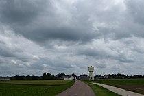 Entrée D10 château d'eau église Sainte Croix Baigneaux Eure-et-Loir France.jpg