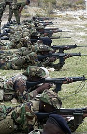 Soldiers from the Jamaica Defence Force (JDF) act as the opposing force (OPFOR) and fire their FN FALs during the Tradewinds 2002 Field Training Exercise (FTX), on the island of Antigua.