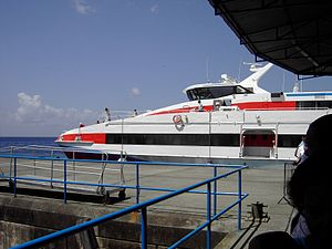 Transport in Dominica - Ferries transport people to the port in Roseau