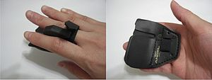 Finger tab - A tab worn on the right hand.