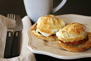 Eggs Benedict—a split English muffin, Ca...