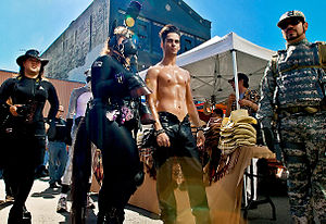 "Folsom Street Fair - A mixture of kink and leather subcultures mix at the festival. The man on the right may be into uniform and military interests while these other 2007 fair-goers seem to be interested in animal roleplay including a bare-chested man with his ""pony""."