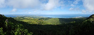 Mount Tapochau - A panorama taken from the top of Mount Tapochau. In the distance to the left is Tinian; to the right is Garapan