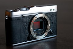 Fujifilm X-E1 camera body without lens, exposing APS-C sized 16 megapixel sensor.jpg