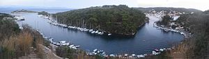 Paxi - The natural port of Gaios, created by the islet St Nicolas
