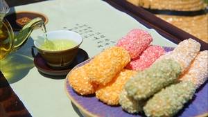 Gangjeong - Colorful gangjeong (sweet rice puffs) with nokcha (green tea)