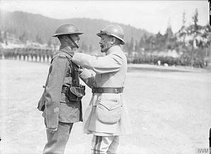 23rd Division (United Kingdom) - General Jean Graziani, the C-in-C of the French Army in Italy, decorating a soldier of the 11th Battalion, Sherwood Foresters (Nottinghamshire and Derbyshire Regiment), with the Croix de Geurre. Photograph taken during the presentation ceremony of decorations to soldiers of both armies after the Battle of the Piave River. Granezza, 12 July 1918