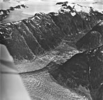 Gilkey Glacier, terminus of branch of valley glacier, ice field and hanging glacier in the background, August 27, 1969 (GLACIERS 6338).jpg