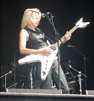 Girlschool - Lead guitarist Jackie 'Jax' Chambers playing live at Bloodstock Open Air 2009
