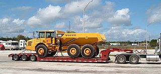 Lowboy (trailer) semi-trailer with two drops in deck height