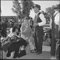 Granada Relocation Center, Amache, Colorado. Here, and elderly couple enjoy an ice cream cone while . . . - NARA - 539907.tif