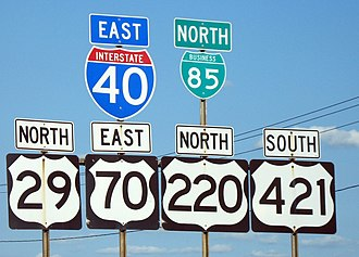 U.S. Route 421 - Concurrent highways through Greensboro, North Carolina (September 13, 2006). This sign is outdated, as US 421 has been reassigned to the southern segment of the Greensboro Urban Loop.