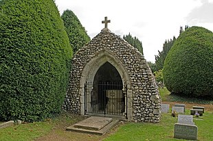 The squat grotto at St Mary's Church, Headley is the reworked remains of a 15th century church.
