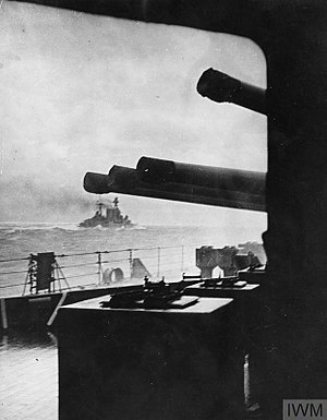 Battle of the Denmark Strait - Last picture of Hood as a fighting unit, sailing towards her rendezvous with Bismarck. In the foreground three guns from Prince of Wales' 'A' turret can be seen. The guns in the photo appear to be from a triple turret, but untrimmed versions of this photo reveal that it is a quad, with one gun independently elevated to a position and therefore out of view in this rendering.