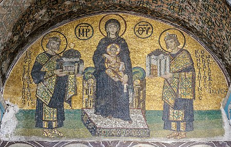 Hagia Sophia mosaic depicting the Virgin Mary holding the Child Christ on her lap. On her right side stands Justinian, offering a model of the Hagia Sophia. On her left, Constantine I presents a model of Constantinople. Hagia Sophia Southwestern entrance mosaics 2.jpg
