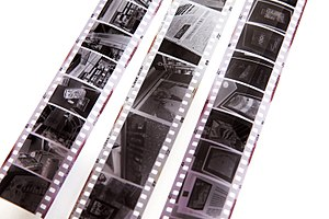 Half-frame camera - Half-frame film (left and right) with standard 35mm (centre)