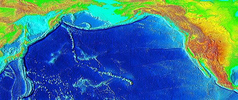 Raised-relief map of the Pacific basin, showing seamounts and islands trailing the Hawaiʻi hotspot in a long line terminating near the Russian island of Kamchatka Peninsula in Russia.