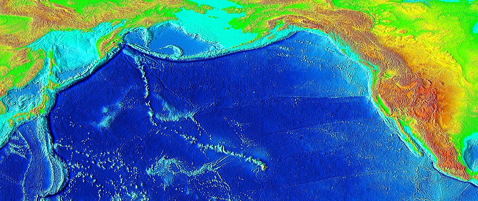 Raised-relief map of the Pacific basin, showing seamounts and islands trailing the Hawaii hotspot in a long line terminating near the Russian island of Kamchatka Peninsula in Russia.