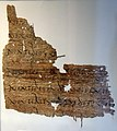 Hawara Papyrus 24, with line of Virgil's Aeneid repeated 7 times, Book 2, line 601. Recto. Latin language. 1st century CE. From Hawara, Egypt. On display at the British Museum in London.jpg