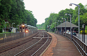 Ho-Ho-Kus station - A train arriving in Ho-Ho-Kus on its way towards Hoboken Terminal in 2011. The station depot is visible on the right side.