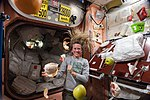 ISS-36 Karen Nyberg with fresh fruit in the Unity node.jpg