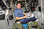 ISS-45 Sergey Volkov works inside the Zvezda Service Module.jpg