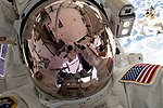 ISS-59 EVA-1 (l) Nick Hague takes a space-selfie on the Port-4 truss.jpg